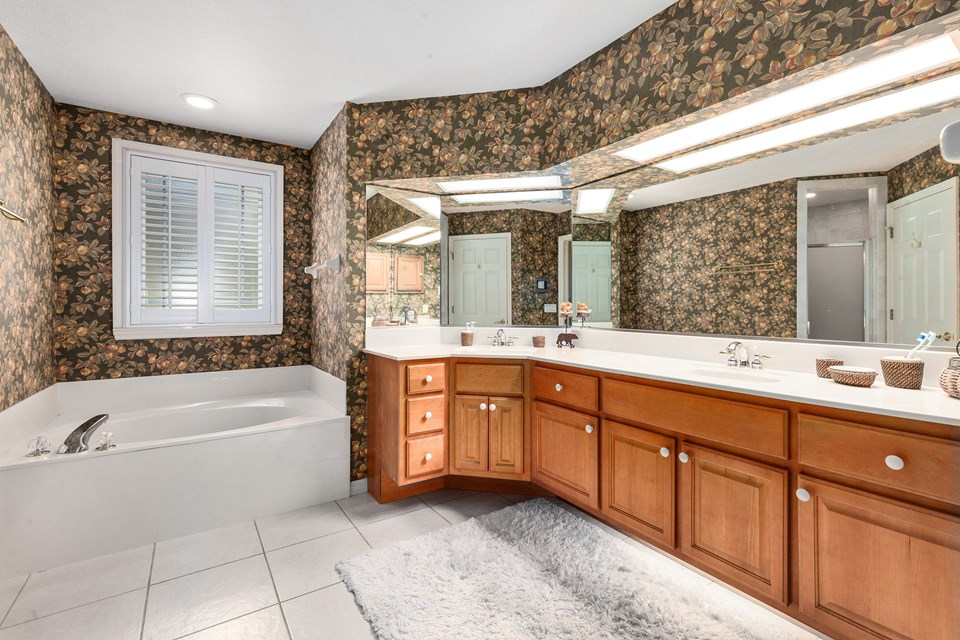 master bath has dual vanities and garden bath