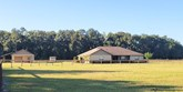 5 acre horse farm in citra has a quality built 3/2, fantastic workshop, barn & more!