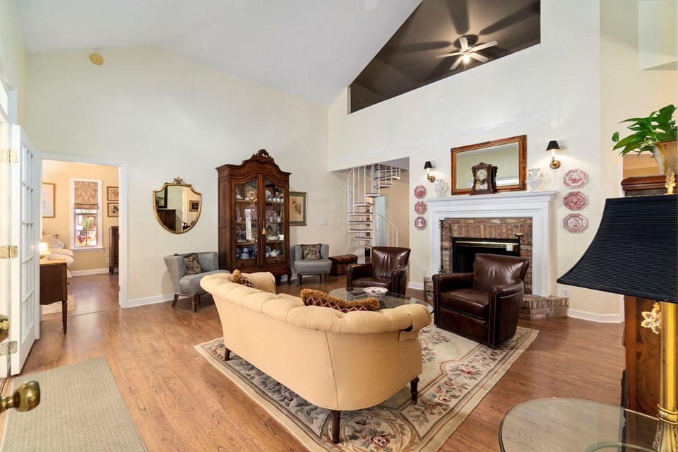 living room withj antique brick fireplace