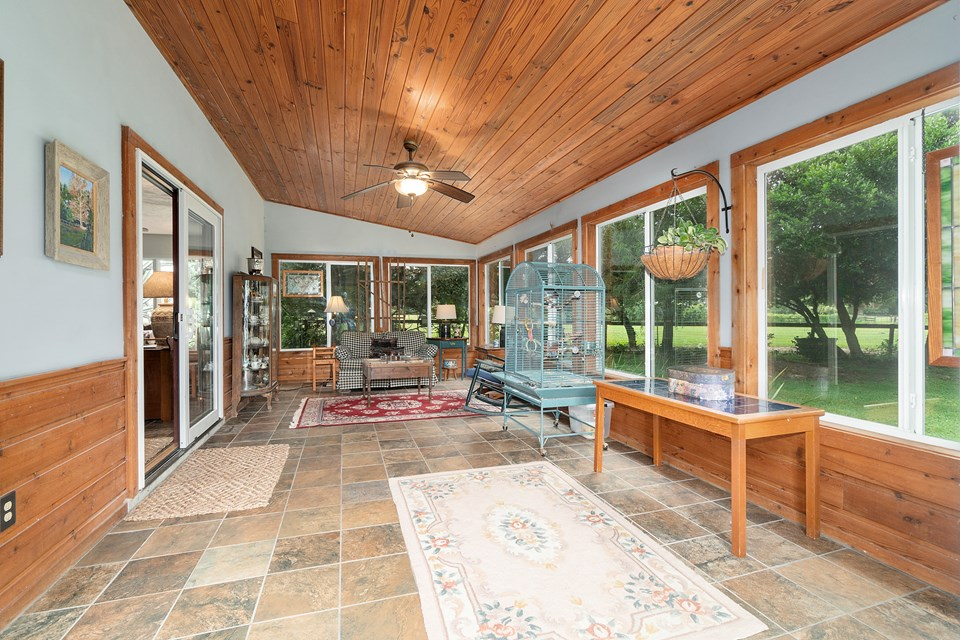 tiled sunroom is nearly 24 feet in length